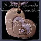 18 Karat Yellow Gold, Sterling Silver and Diamond Anniversary Heart Pendant Image