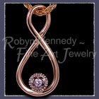14 Karat Yellow Gold and Diamond 'Eternity' Pendant Image