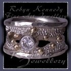 10 Karat Yellow Gold, Sterling Silver and Cubic Zirconia  'Chic' Ring Image