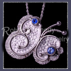 Sterling Silver, Glacier and Paradise Blue Genuine Diffused Topaz 'Flutterby' Pendant / Brooch Image