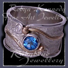 10 Karat Yellow Gold, Sterling Silver and Swiss Blue Topaz, 'Serenity' Ring Image
